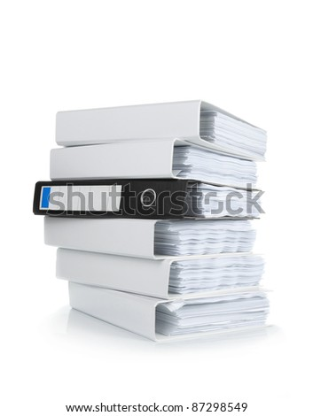 A pile of ring binders isolated on the white background - stock photo