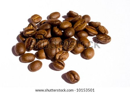 """A pile of roasted """"Arabica"""" coffee beans lying on white background. - stock photo"""