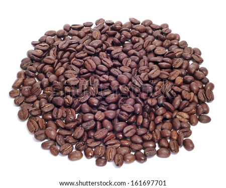 a pile of roasted coffee beans on a white background