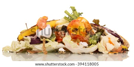 A pile of rotting food waste is isolated on a white background. - stock photo