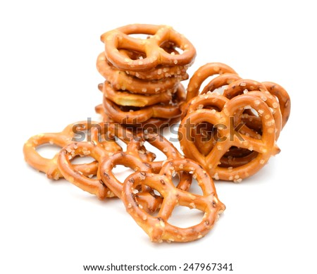 A pile of salty snacks on white background. - stock photo