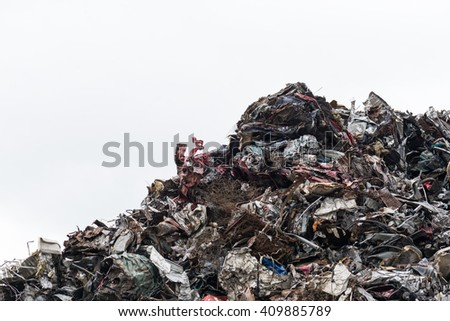 a pile of scrap metal isolated on white background - stock photo