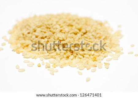 A pile of sesame seeds - stock photo