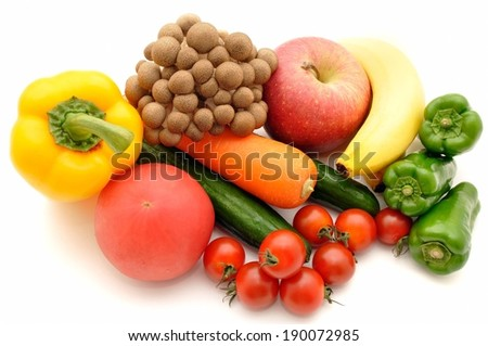 A pile of several fresh fruits and vegetables - stock photo