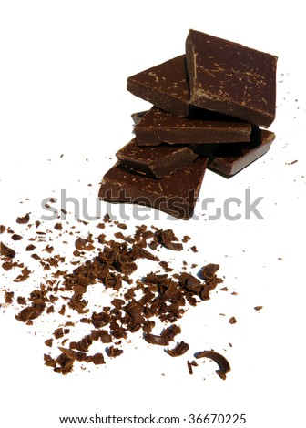 a pile of solid and grated chocolate isolated white