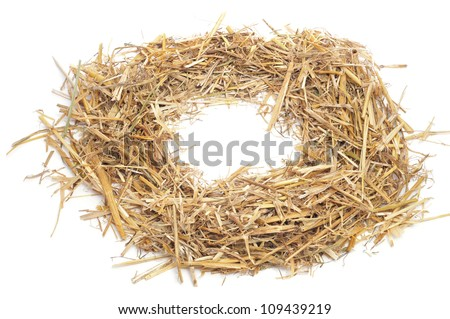 a pile of straw forming a round frame on a white background with a blank space inside - stock photo