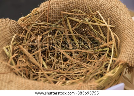 a pile of straw on a hemp sack background