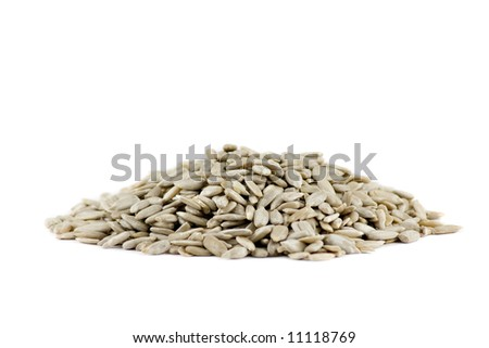 A pile of Sunflower seeds isolated on white background - stock photo