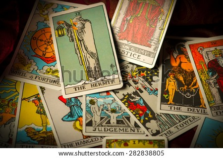 A pile of tarot trump cards jumbled, scattered and haphazardly arranged. - stock photo