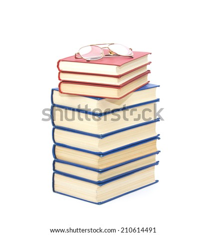 A pile of the books with eyeglass isolated on white  background - stock photo