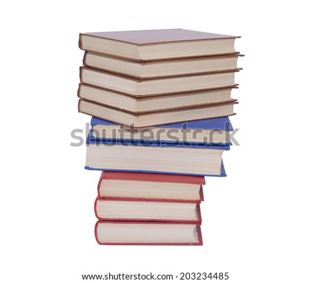 A pile of the red and blue books isolated on white background - stock photo