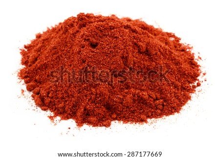 A pile of the spice paprika isolated on white