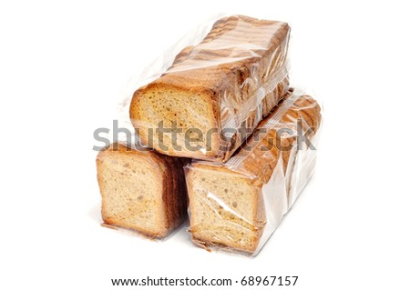 a pile of toast packs isolated on a white background - stock photo