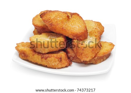 a pile of torrijas, typical Lent spanish sweet, on a white background