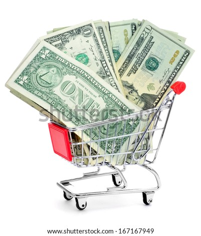 a pile of US dollar banknotes in a shopping cart - stock photo