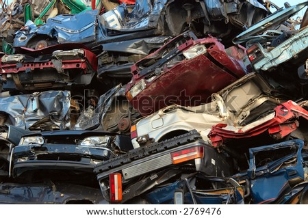 a pile of used cars - stock photo