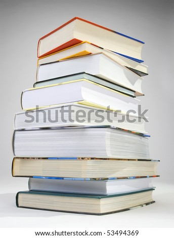 A pile of various color of hard cover books - stock photo