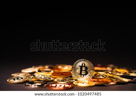 A pile of various Cryptocurrencies with one Bitcoin standing out