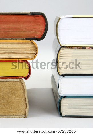 A pile of various new and old hardcover books - stock photo