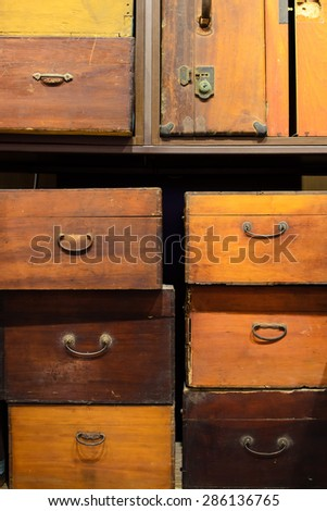 A pile of vintage, old-fashioned wooden boxes and suitcases. - stock photo