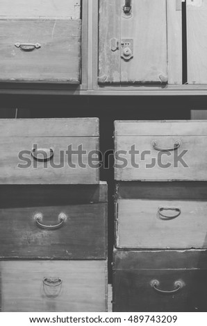 A pile of vintage, old-fashioned wooden boxes and suitcases. Black and white image.