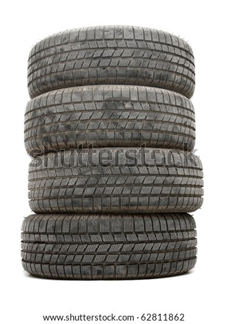 A pile of winte tyres on white background - stock photo
