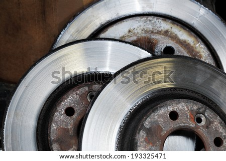 A Pile of worn out brake disks - stock photo