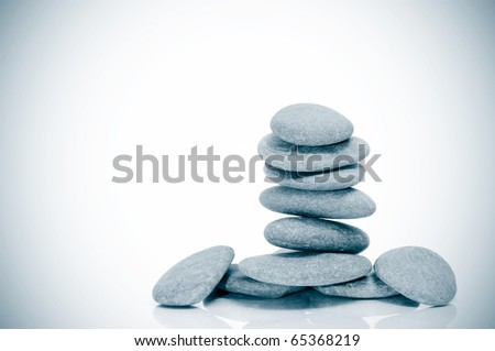 a pile of zen stones on a vignetted background