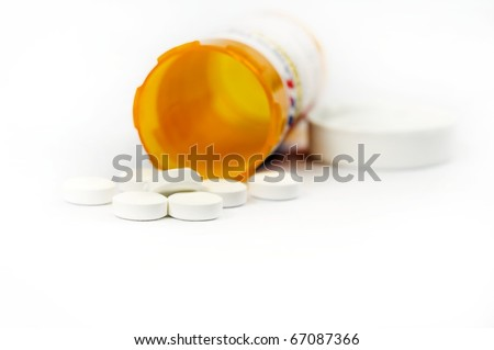 A pill box with tablets on a white background - stock photo