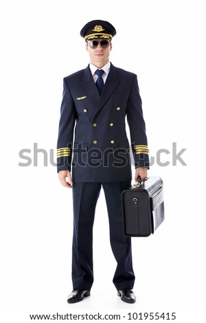 A pilot in uniform on a white background - stock photo