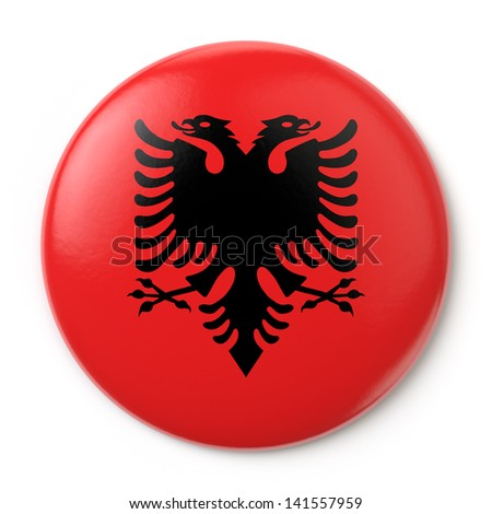 A pin button with the Albanian flag. Isolated on white background with clipping path. - stock photo