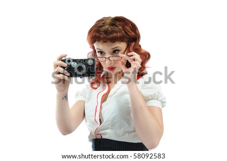 A pin up librarian with a vintage camera. - stock photo