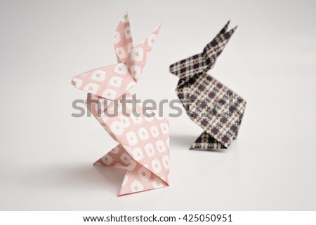 A pink and black rabbit origami - stock photo