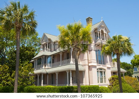 A pink  Battery Victorian era and style of house in Charleston, South Carolina. - stock photo