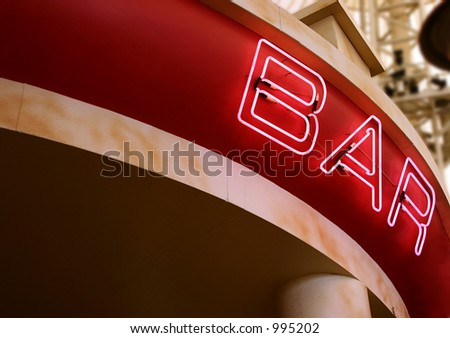 A pink neon sign above a bar - stock photo