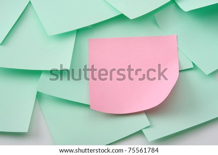 A pink note on green ones - stock photo