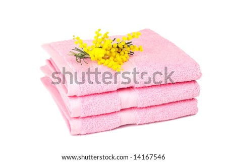 A pink towels stacked with yellow flowers isolated on white background - stock photo