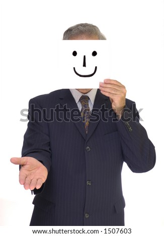 A pinstripe-suited businessman hold out his hand for a handshake with a home-made smiley mask in front of his face. - stock photo