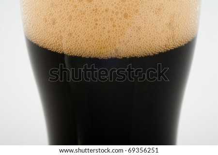 A pint of stout beer close up - stock photo