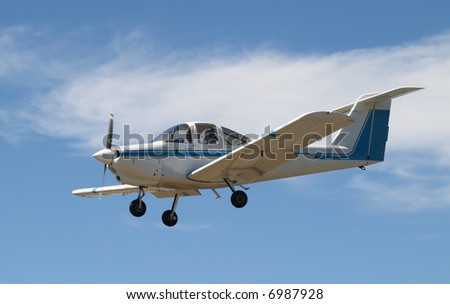 A Piper Tomahawk P-38 Trainer plane on final approach - stock photo