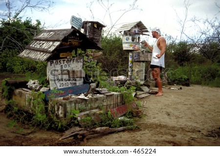 A pirate mails a letter in the Post Office on the Galapagos Islands - stock photo