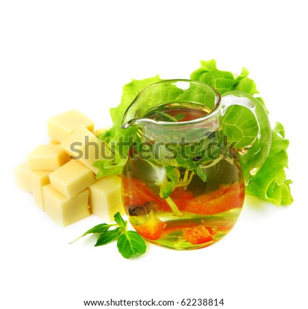 a pitcher of olive oil and herbs. Shallow DOF