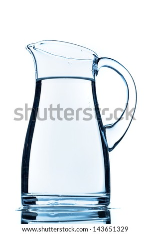 a pitcher of water against white background, symbol photo for drinking water, water demand and consumption - stock photo