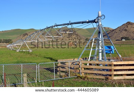 A pivot Irrigation Machine on a farm in North Canterbury, New Zealand ensures that fields are green and productive all year round.