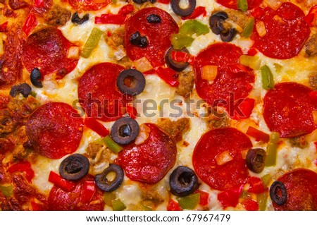 A pizza with Pepperoni, Sausage, Peppers, Onions, and Cheese. - stock photo