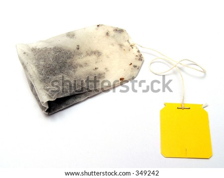 A plain yellow tagged tea bag with clear background - stock photo