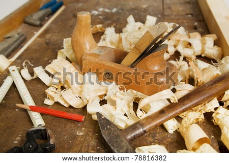 A plane in a carpentry workshop. Tools as a carpenter. - stock photo