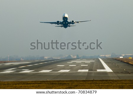 A plane is taken off - stock photo