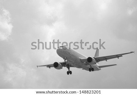 A plane landing in stormy weather - stock photo