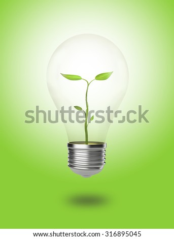 A Plant is growing in a light bulb surrounded by green background